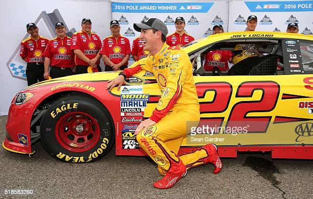 Joey Logano driver of the Shell Pennzoil Ford poses with the Coors Light Pole Award after qualifying for pole position for the NASCAR Sprint Cup...