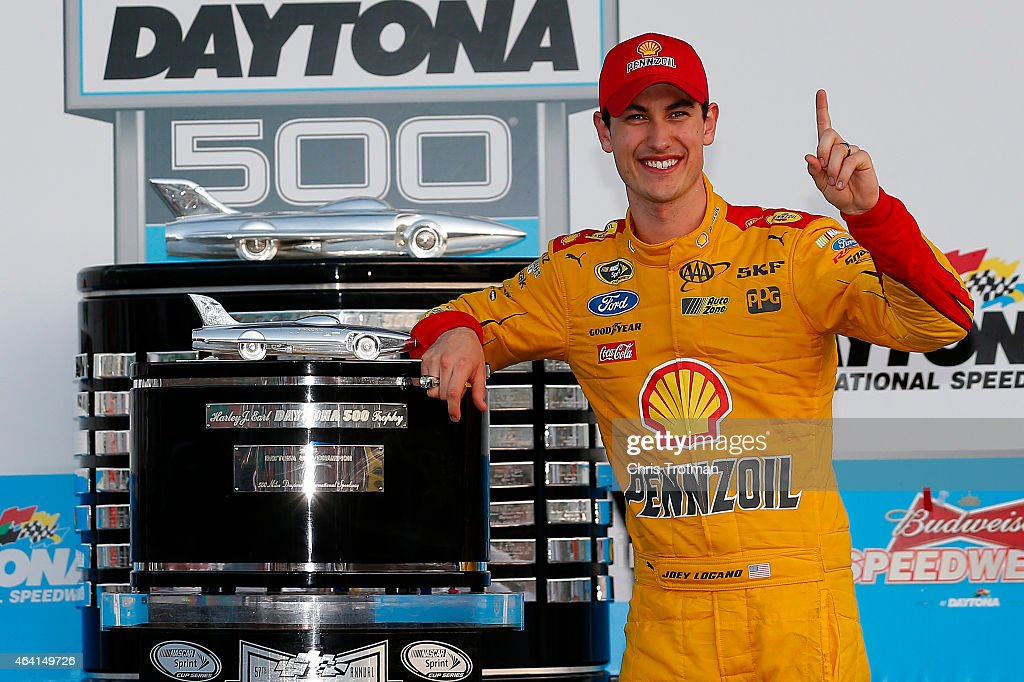 Joey Logano, driver of the #22 Shell Pennzoil Ford, poses with the The Harley J. Earl Trophy in Victory Lane after winning the NASCAR Sprint Cup Series 57th Annual Daytona 500 at Daytona International Speedway on February 22, 2015 in Daytona Beach, Florida.