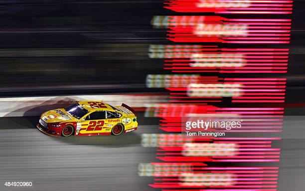 Joey Logano driver of the Shell Pennzoil Ford races during the NASCAR Sprint Cup Series IRWIN Tools Night Race at Bristol Motor Speedway on August 22...