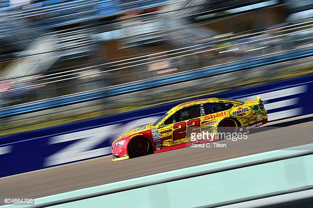 Joey Logano driver of the Shell Pennzoil Ford races during the NASCAR Sprint Cup Series Ford EcoBoost 400 at HomesteadMiami Speedway on November 20...
