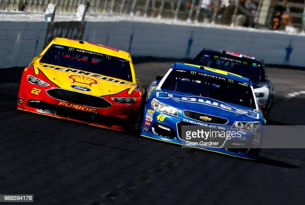 Joey Logano driver of the Shell Pennzoil Ford races Jimmie Johnson driver of the Lowe's Chevrolet during the Monster Energy NASCAR Cup Series...