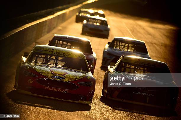 Joey Logano driver of the Shell Pennzoil Ford races Kyle Busch driver of the MM's Toyota during the NASCAR Sprint Cup Series Ford EcoBoost 400 at...