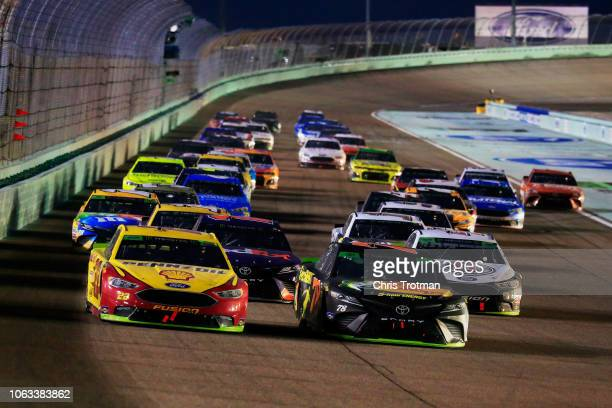 Joey Logano driver of the Shell Pennzoil Ford races Martin Truex Jr driver of the Bass Pro Shops/5hour ENERGY Toyota during the Monster Energy NASCAR...