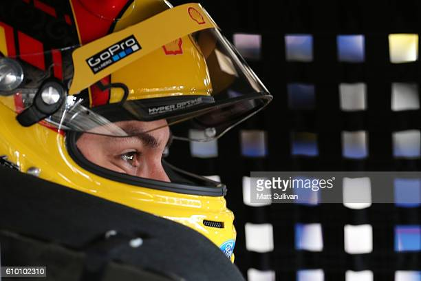 Joey Logano driver of the Shell Pennzoil Ford sits in his car during practice for the NASCAR Sprint Cup Series Bad Boy Off Road 300 at New Hampshire...