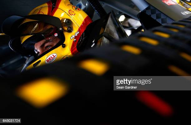 Joey Logano driver of the Shell Pennzoil Ford sits in his car during practice for the 59th Annual DAYTONA 500 at Daytona International Speedway on...