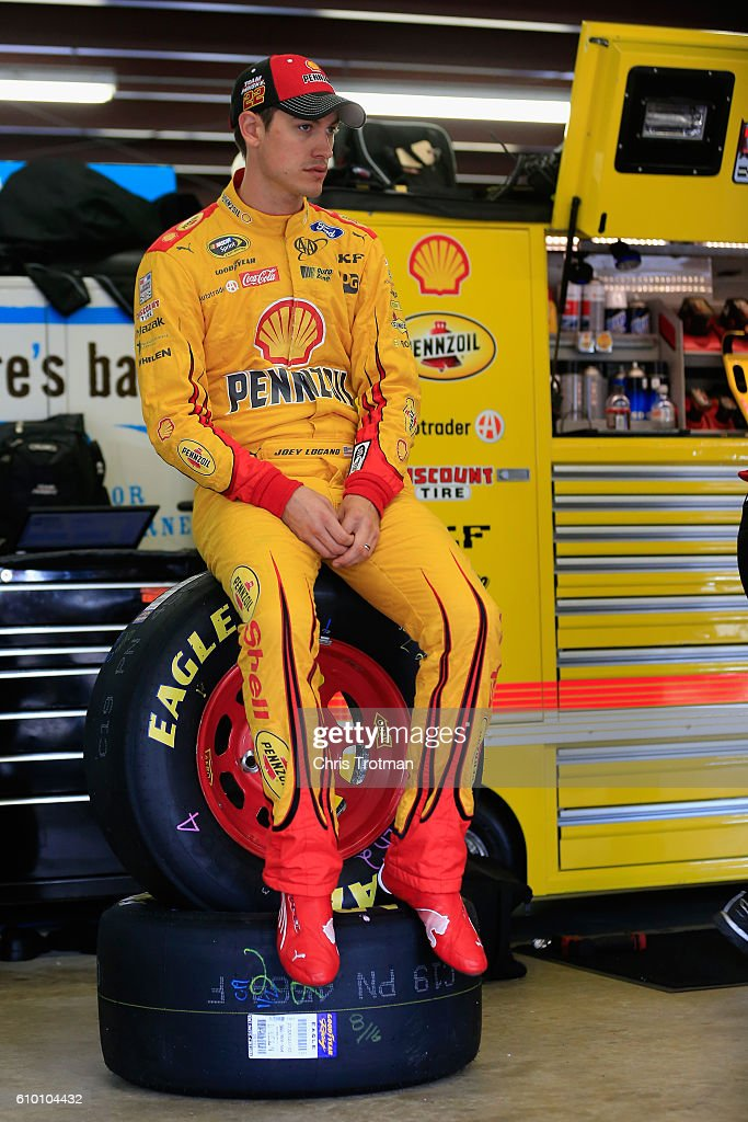 Joey Logano, driver of the #22 Shell Pennzoil Ford, sits in the garage during practice for the NASCAR Sprint Cup Series Bad Boy Off Road 300 at New Hampshire Motor Speedway on September 24, 2016 in Loudon, New Hampshire.
