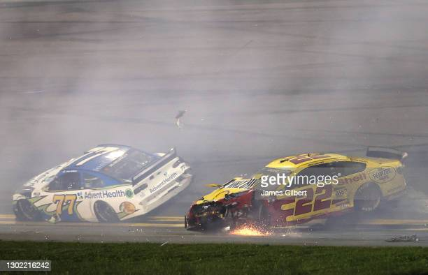 Joey Logano, driver of the Shell Pennzoil Ford, spins after an on-track incident during the NASCAR Cup Series 63rd Annual Daytona 500 at Daytona...