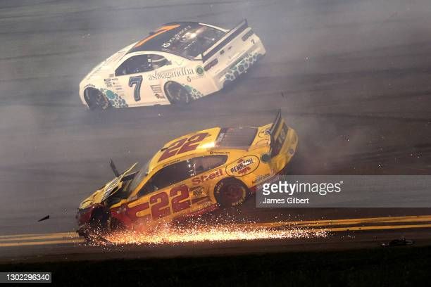Joey Logano, driver of the Shell Pennzoil Ford, spins after an on-track incident as ct7 drives pass during the NASCAR Cup Series 63rd Annual Daytona...