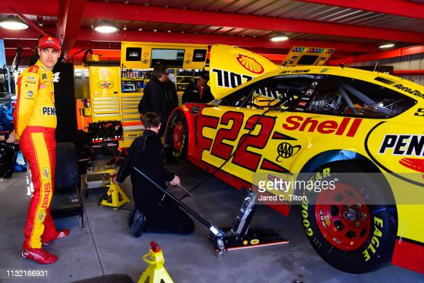 Joey Logano driver of the Shell Pennzoil Ford stands in the garage area during practice for the Monster Energy NASCAR Cup Series STP 500 at...
