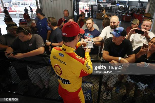 Joey Logano driver of the Shell Pennzoil Ford stands in the garage area during practice for the Monster Energy NASCAR Cup Series 1000Bulbscom 500 at...