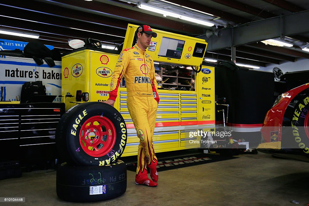 Joey Logano, driver of the #22 Shell Pennzoil Ford, stands in the garage during practice for the NASCAR Sprint Cup Series Bad Boy Off Road 300 at New Hampshire Motor Speedway on September 24, 2016 in Loudon, New Hampshire.