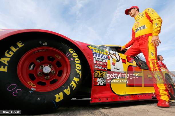 Joey Logano driver of the Shell Pennzoil Ford stands on the grid during qualifying for the Monster Energy NASCAR Cup Series Bank of America Roval 400...