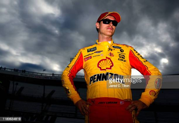 Joey Logano, driver of the Shell Pennzoil Ford, stands on the grid during qualifying for the Monster Energy NASCAR Cup Series First Data 500 at...