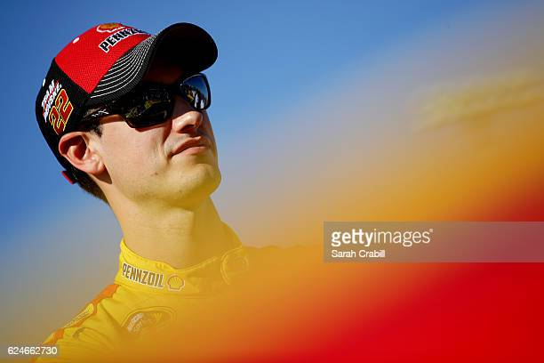 Joey Logano driver of the Shell Pennzoil Ford stands on the grid prior to the NASCAR Sprint Cup Series Ford EcoBoost 400 at HomesteadMiami Speedway...