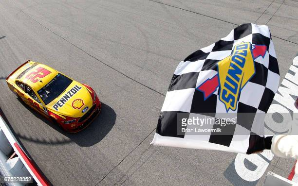 Joey Logano driver of the Shell Pennzoil Ford takes the checkered flag to win the Monster Energy NASCAR Cup Series Toyota Owners 400 at Richmond...