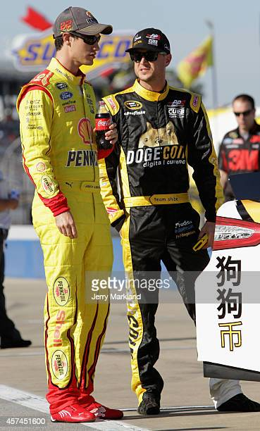 Joey Logano driver of the Shell Pennzoil Ford talks with Josh Wise driver of the Dogecoin/Redditcom Ford during qualifying for the NASCAR Sprint Cup...