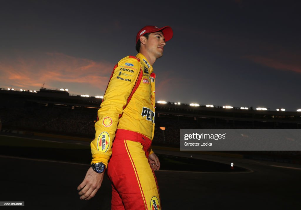 Joey Logano, driver of the #22 Shell Pennzoil Ford, walks on the grid during qualifying for the Monster Energy NASCAR Cup Series Bank of America 500 at Charlotte Motor Speedway on October 6, 2017 in Charlotte, North Carolina.