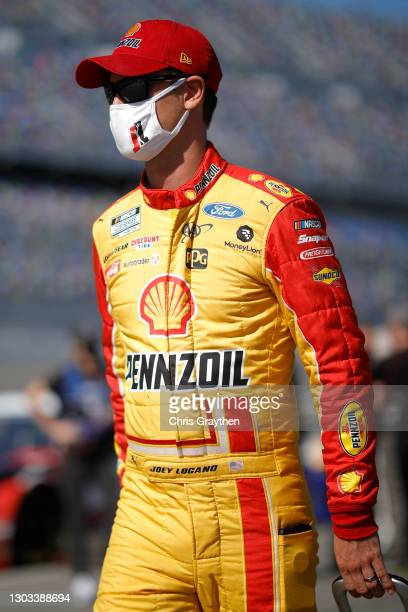 Joey Logano, driver of the Shell Pennzoil Ford, walks the grid prior to the NASCAR Cup Series O'Reilly Auto Parts 253 at Daytona International...