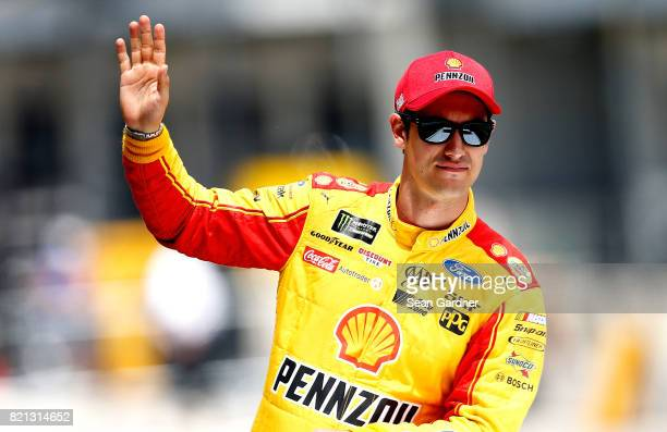 Joey Logano, driver of the Shell Pennzoil Ford, waves to the crowd prior to the start of the Monster Energy NASCAR Cup Series Brickyard 400 at...