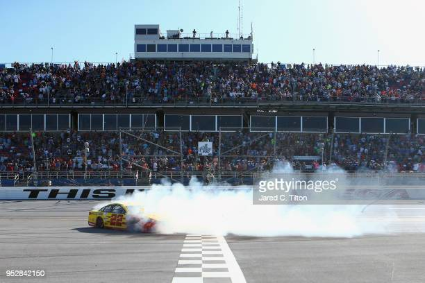 Joey Logano driver of the Shell Pennzoil/Autotrader Ford celebrates with a burnout after winning the Monster Energy NASCAR Cup Series GEICO 500 at...
