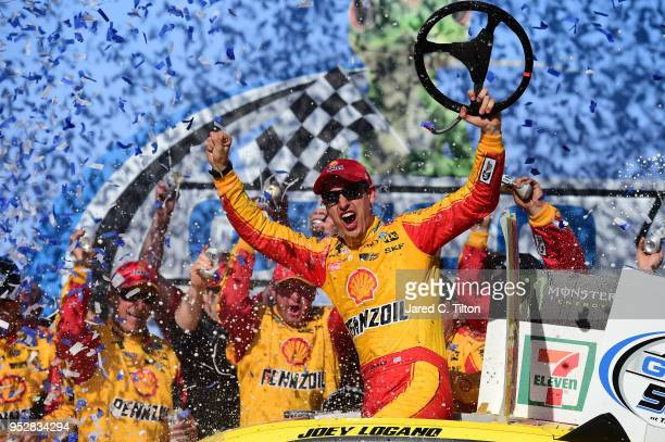 Joey Logano, driver of the Shell Pennzoil/Autotrader Ford, celebrates in Victory Lane after winning the Monster Energy NASCAR Cup Series GEICO 500 at...