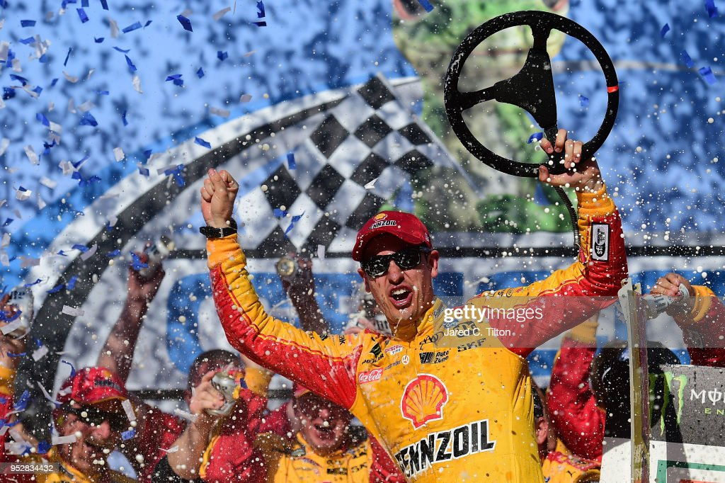 Joey Logano, driver of the #22 Shell Pennzoil/Autotrader Ford, celebrates in Victory Lane after winning the Monster Energy NASCAR Cup Series GEICO 500 at Talladega Superspeedway on April 29, 2018 in Talladega, Alabama.