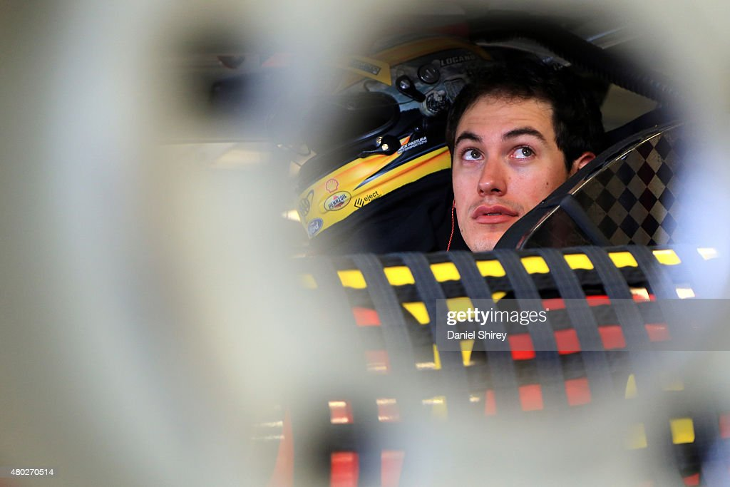 Joey Logano, driver of the #22 Shell Pennzoil/AutoTrader Ford, sits in his car during practice for the NASCAR Sprint Cup Series Quaker State 400 Presented by Advance Auto Parts at Kentucky Speedway on July 10, 2015 in Sparta, Kentucky.