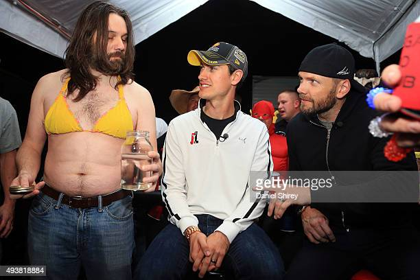 Joey Logano driver of the Shell Penzoil Ford participates in the filming of an episode of E's The Soup with TV personality Joel McHale and Mankini a...