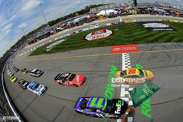 Joey Logano driver of the ShellPennzoil Ford and Denny Hamlin driver of the FedEx Ground Toyota lead the field to start the NASCAR Sprint Cup Series...