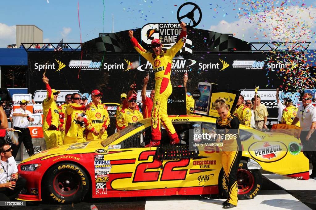 Joey Logano, driver of the #22 Shell-Pennzoil Ford, celebrates in Victory Lane after winning the NASCAR Sprint Cup Series 44th Annual Pure Michigan 400 at Michigan International Speedway on August 18, 2013 in Brooklyn, Michigan.