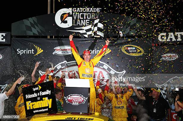 Joey Logano, driver of the Shell-Pennzoil Ford, celebrates in Victory Lane after winning the NASCAR Sprint Cup Series Toyota Owners 400 at Richmond...