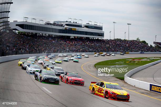 Joey Logano driver of the ShellPennzoil Ford leads the field to start the NASCAR Sprint Cup Series Toyota Owners 400 at Richmond International...