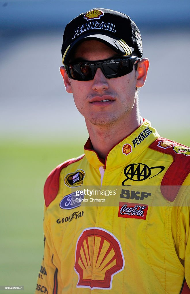 Joey Logano, driver of the #22 Shell-Pennzoil Ford, looks on during qualifying for the NASCAR Sprint Cup Series Geico 400 at Chicagoland Speedway on September 13, 2013 in Joliet, Illinois.