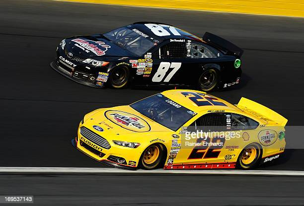 Joey Logano driver of the ShellPennzoil Ford races Joe Nemechek driver of the NEMCO Motorsports Toyota during the NASCAR Sprint Cup Series CocaCola...