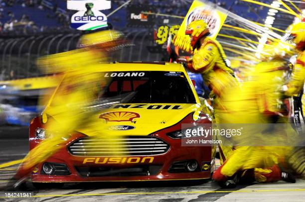 Joey Logano driver of the ShellPennzoil / Hertz Ford pits during the NASCAR Sprint Cup Series Bank of America 500 at Charlotte Motor Speedway on...
