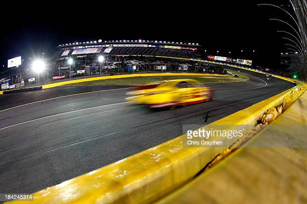 Joey Logano driver of the ShellPennzoil / Hertz Ford races the NASCAR Sprint Cup Series Bank of America 500 at Charlotte Motor Speedway on October 12...