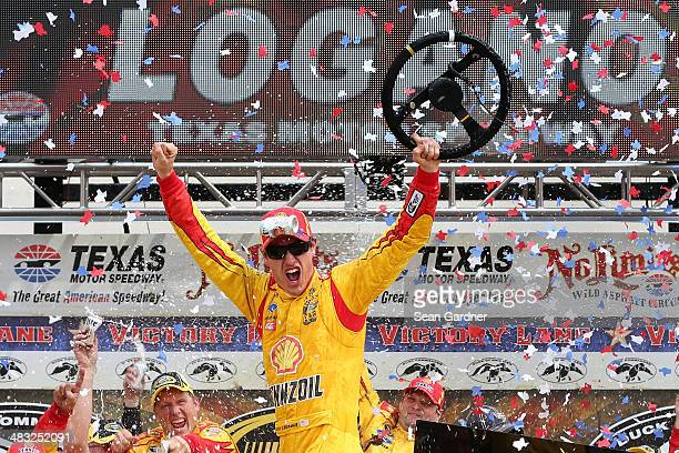 Joey Logano driver of the ShellPennzoil/Hertz Ford celebrates in Victory Lane after winning the NASCAR Sprint Cup Series Duck Commander 500 at Texas...