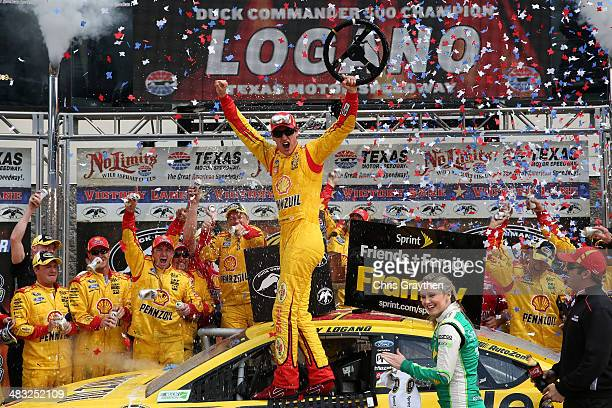 Joey Logano driver of the ShellPennzoil/Hertz Ford celebrates in Victory Lane with Texas Motor Speedway President Eddie Gossage during the NASCAR...