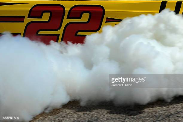 Joey Logano driver of the ShellPennzoil/Hertz Ford celebrates with a burnout after winning the NASCAR Sprint Cup Series Duck Commander 500 at Texas...