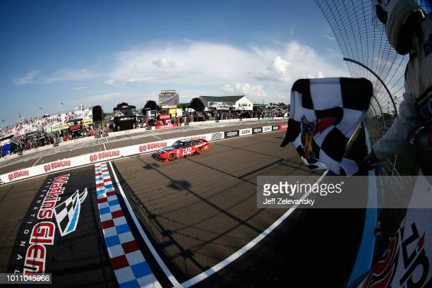 Joey Logano driver of the Snap On Ford crosses the finish line to win the NASCAR Xfinity Series Zippo 200 at Watkins Glen International on August 4...
