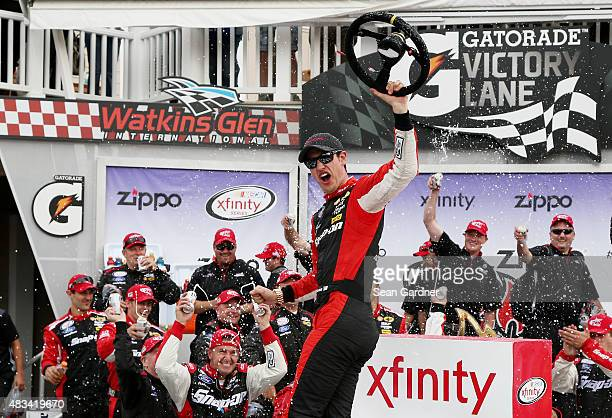 Joey Logano, driver of the Snap-on Ford, celebrates in Victory Lane after winning the NASCAR XFINITY Series Zippo 200 at Watkins Glen International...