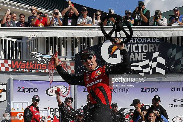 Joey Logano driver of the SnapOn Ford celebrates in victory lane after winning the NASCAR XFINITY Series Zippo 200 at Watkins Glen International on...