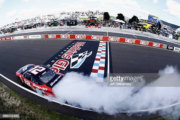 Joey Logano driver of the SnapOn Ford celebrates with a burn out after winning the NASCAR XFINITY Series Zippo 200 at Watkins Glen International on...