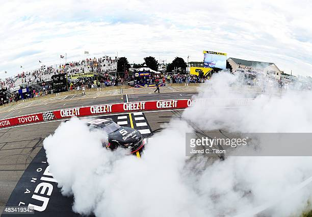 Joey Logano, driver of the Snap-on Ford, celebrates with a burnout after winning the NASCAR XFINITY Series Zippo 200 at Watkins Glen International on...