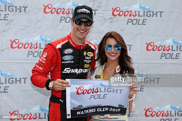 Joey Logano driver of the Snapon Ford poses with Miss Coors Light Amanda Mertz and the Coors Light Pole award after qualifying for pole position for...