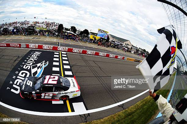 Joey Logano, driver of the Snap-on Ford, takes the checkered flag to win the NASCAR XFINITY Series Zippo 200 at Watkins Glen International on August...