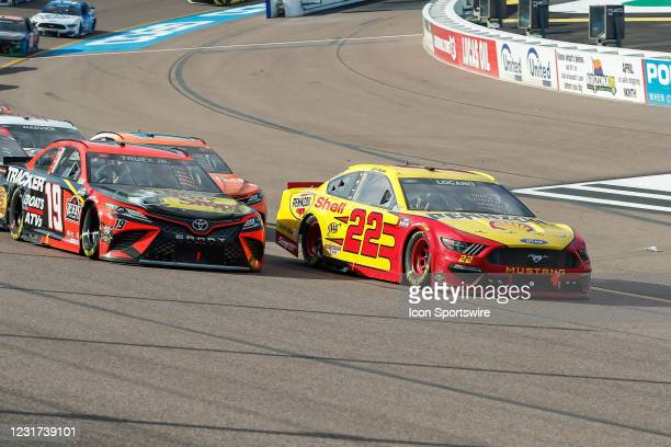 Joey Logano, driver of the Team Penske Shell Pennzoil Ford Mustang and Martin Truex Jr., driver of the Joe Gibbs Racing Bass Pro Shops Toyota Camry,...