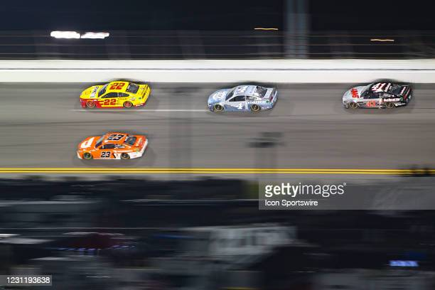 Joey Logano, driver of the Team Penske Shell Pennzoil Ford Mustang, Kevin Harvick, driver of the Stewart-Haas Racing Busch Light #TheCrew Ford...