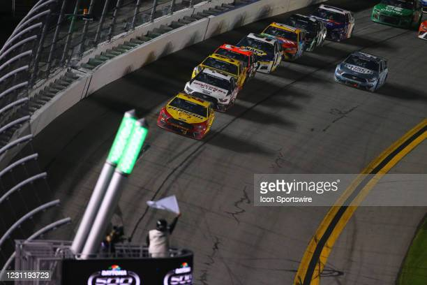 Joey Logano, driver of the Team Penske Shell Pennzoil Ford Mustang, takes the white flag during the Daytona 500 on February 14, 2021 at Daytona...