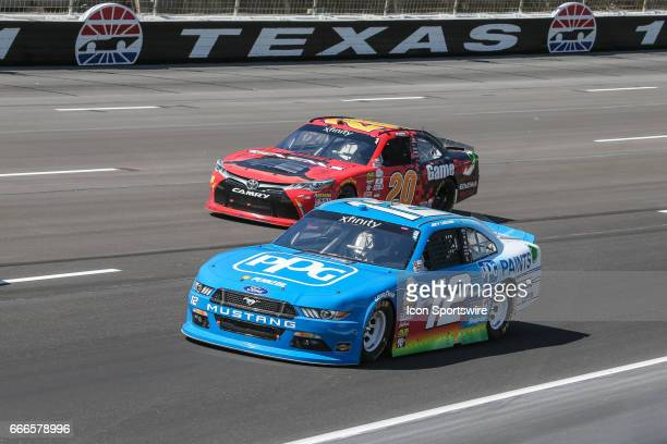 Joey Logano leads Erik Jones in turn 1 during the My Bariatric Solutions NASCAR Xfinity Series race on April 8 2017 at Texas Motor Speedway in Fort...